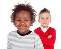 两滑稽儿童笑 图库摄影