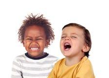 两漂亮的孩子笑 图库摄影
