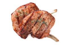 两烤了在白色背景隔绝的猪肉牛排 免版税库存图片