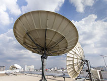 两电信的卫星盘 免版税图库摄影