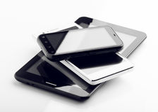 两种巧妙的电话和片剂在白色 免版税库存照片