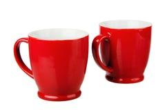 两红色陶瓷杯子 免版税库存图片
