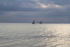 两艘单桅三角帆船 库存图片