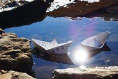 两艘纸船在海 库存图片