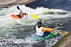 两艘活跃皮艇 免版税图库摄影