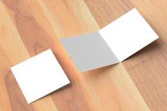 两褶的方形的小册子嘲笑在木背景 3D illustra 库存图片
