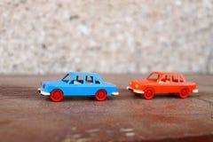 两辆塑料汽车 免版税库存照片