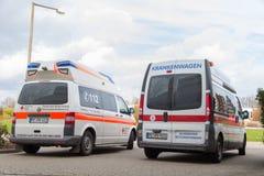 两辆德国救护车车在医院站立 免版税库存图片