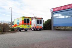 两辆德国救护车车在医院站立 免版税库存照片