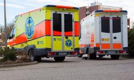 两辆德国救护车车在医院站立 库存照片