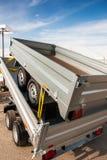 两辆新的金属拖车运输 免版税库存照片