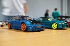 两辆汽车缩样  免版税图库摄影