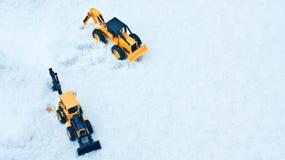 两辆玩具铲车 免版税图库摄影