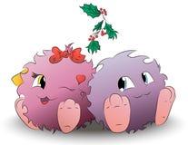 两逗人喜爱的动画片妖怪圣诞节槲寄生 库存照片