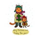 两逗人喜爱的动画片猫、树和礼物 免版税库存照片