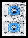两邮票、ITY象征和雪松,国际游人 免版税库存图片