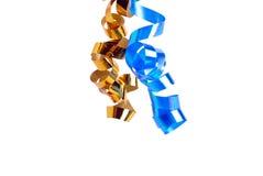 两金黄和在白色隔绝的蓝色丝带 库存照片