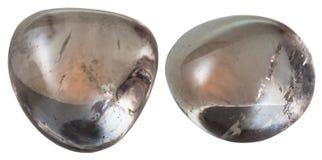 两颗墨晶(发烟性黄玉)宝石 免版税库存照片