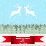 两驯鹿在圣诞节森林里 库存照片