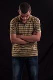 严肃和体贴的青少年的男孩用手横渡 免版税图库摄影