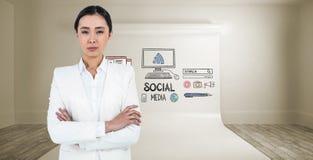 严肃的女实业家的综合图象有横渡的胳膊的 免版税图库摄影
