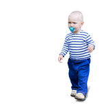 严肃的小孩小孩去室外与在白色的soother安慰者 库存照片