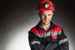 严肃的煤矿工人画象  库存图片
