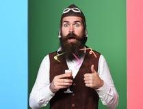严肃的英俊的有胡子的飞行员 库存照片