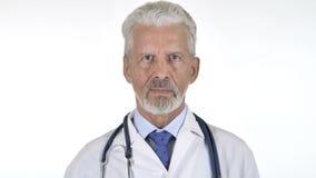 严肃的资深医生Isolated画象白色背景的 股票录像