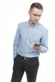 严肃的年轻人谈话在白色背景隔绝的机动性 免版税库存图片