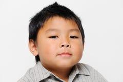严重亚裔的男孩 库存图片