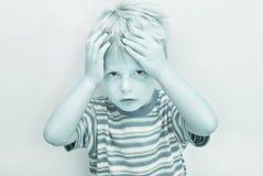 严重儿童的表达式 免版税图库摄影
