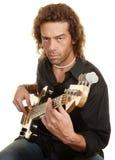 严重的吉他演奏员 免版税库存图片