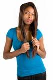 严重非洲裔美国人的可爱的夫人 免版税库存照片