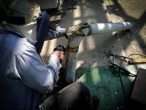 个体防护用品研的管子的工作者人 库存图片