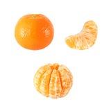 整个和被剥皮的蜜桔果子的汇集隔绝与裁减路线 库存照片
