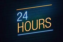 24个小时商店的霓虹灯广告 库存照片