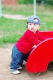 10个月的婴孩年龄在操场的 免版税库存图片