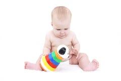 7个月婴孩演奏玩具 免版税库存照片