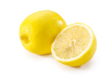 整个柠檬和半特写镜头 库存图片