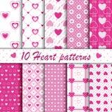 10个桃红色心脏形状无缝的样式收藏 库存图片