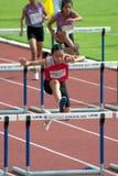 100个m.障碍在泰国打开运动冠军2013年。 库存照片
