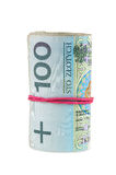 100个PLN波兰钞票滚动了与橡胶 图库摄影