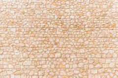 中世纪城堡的背景米黄墙壁 库存图片