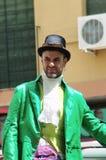 中世纪市场:一件高尔夫球外套的14带着帽子的人 库存图片