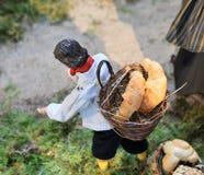 中世纪村庄贝克小雕象 库存图片