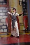 有长的刀片的骑士女孩 免版税库存照片