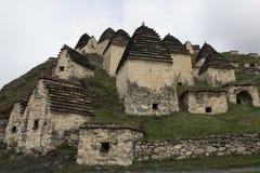 中世纪穹顶复杂在Dargavs村庄  免版税图库摄影