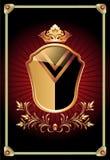 纹章学盾华丽金黄装饰品 免版税库存图片
