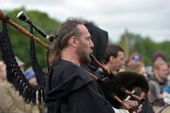 中世纪风笛音乐家 库存照片